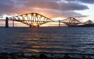 The Forth Bridge at sunset. Image via Forth Bridges.