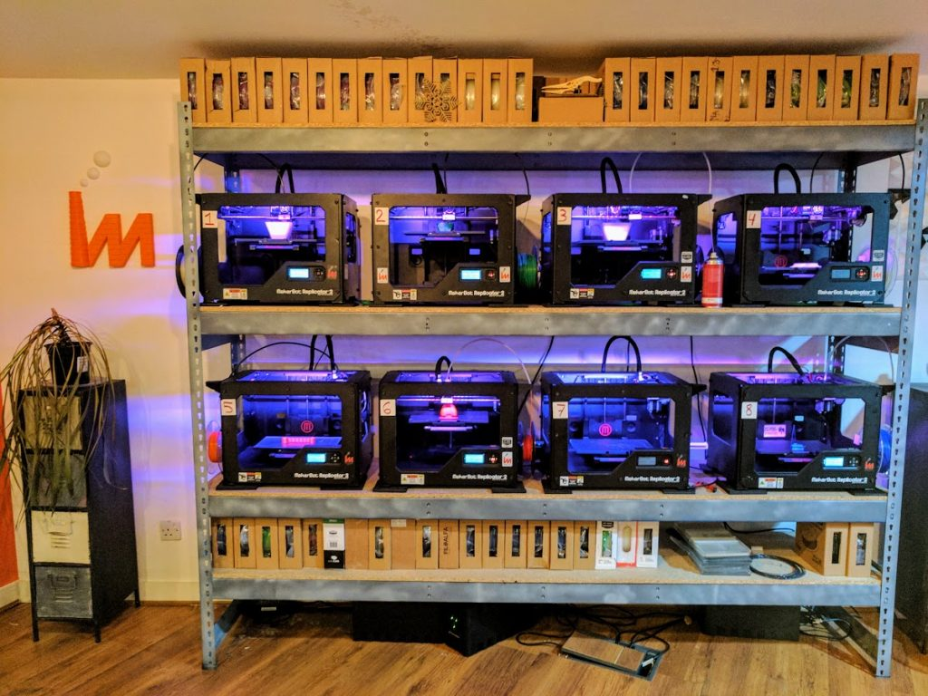 A wall of MakerBot Replicator 2's. Photo by Michael Petch.