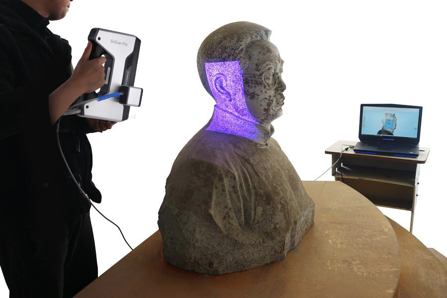 Shining 3D EinScan Pro 3D scanner used to create 3D point cloud of a sculpture. Photo via: PrintLab