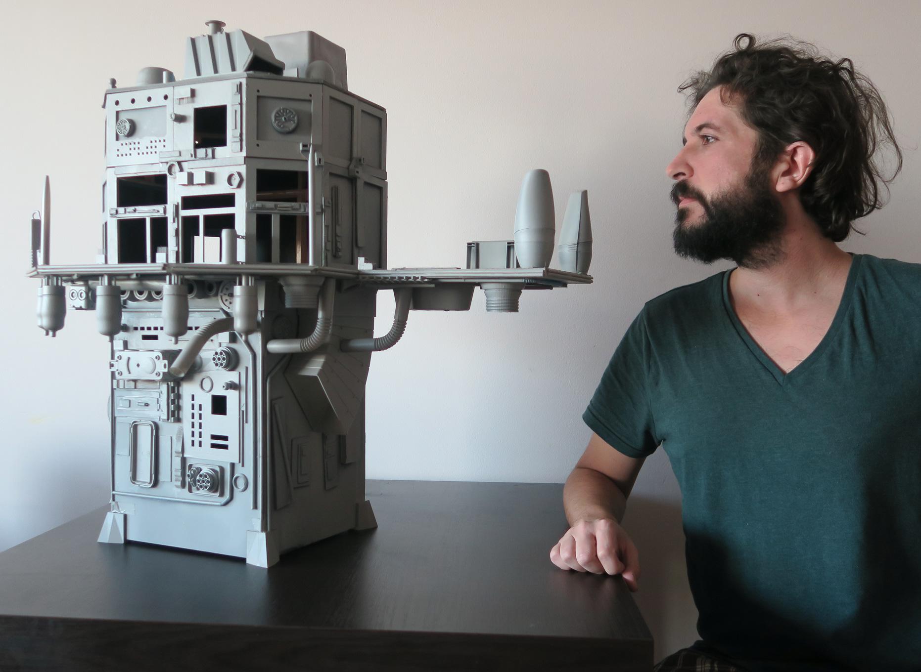 Nicola poses with his 3D printed city structure. Photo via Nicola Piosevan.