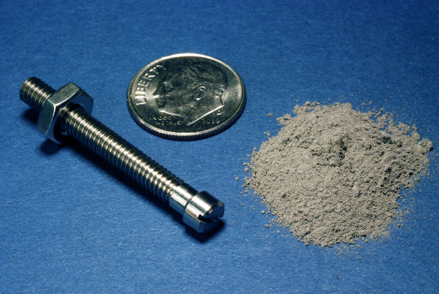 'Finished 1.8 gram titanium bolt made from 1.8 grams of gas atomized titanium powder' next to the metal in powder form. Photo via: Ames Laboratories