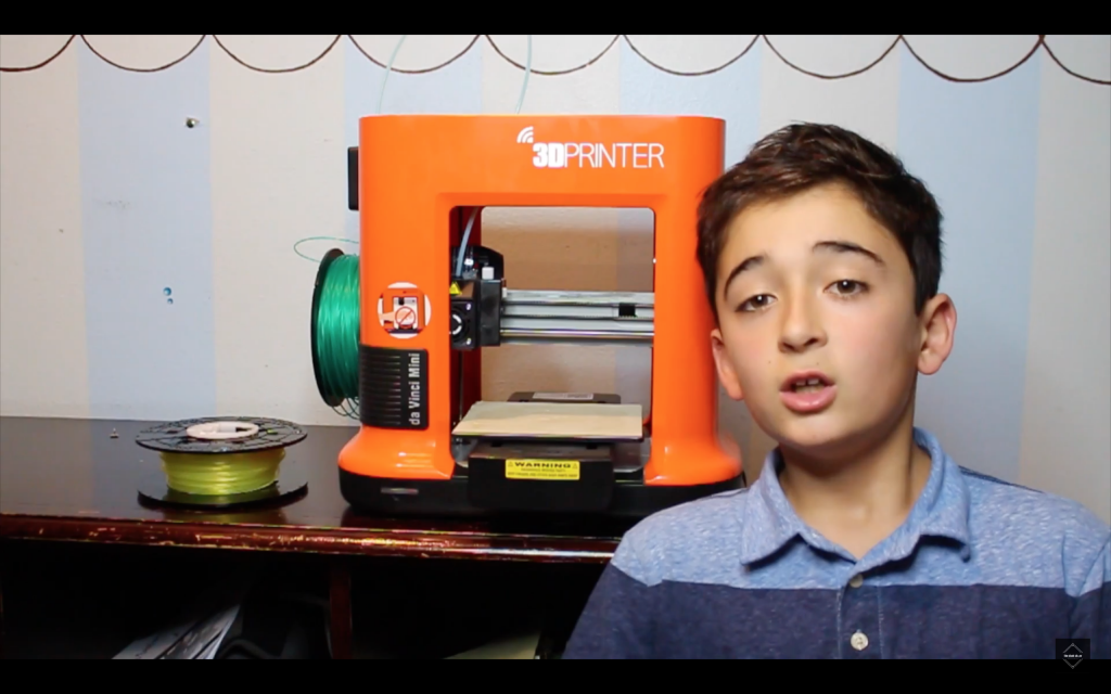 Luca Shakoori and hi Da Vinci Mini 3D printer. Screenshot from the video: What I got for Christmas 2016 - 3D Printer Review