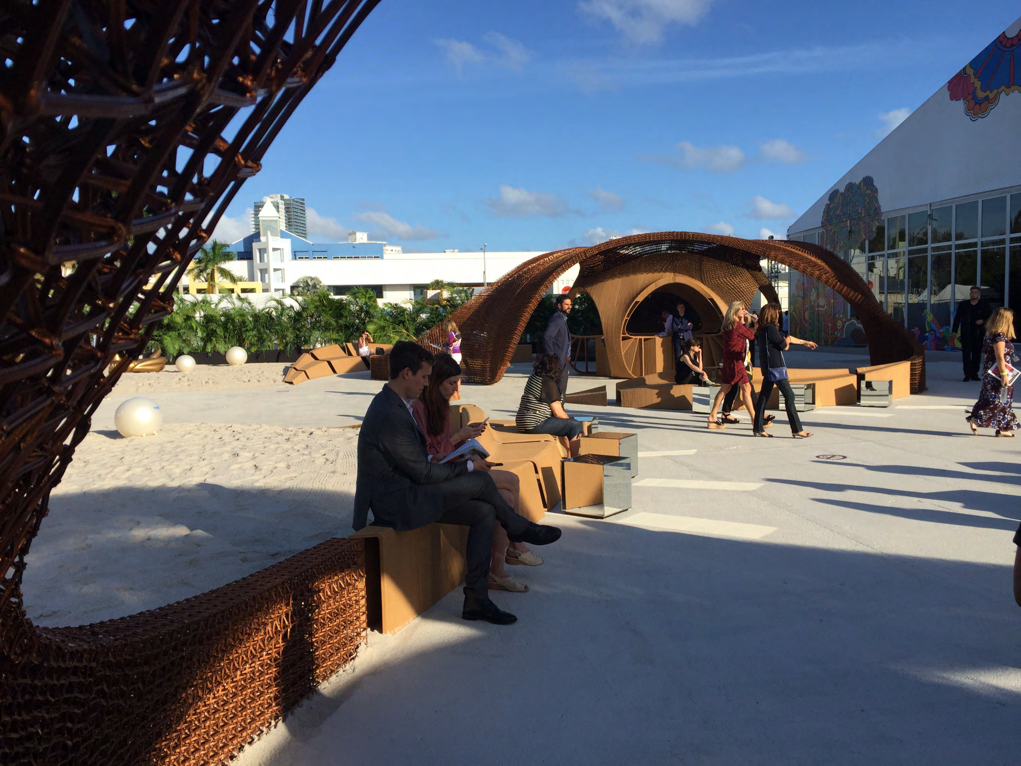People sit on the 3D printed seats which form part of the Flotsam and Jetsam piece. Photo via Branch Technology.