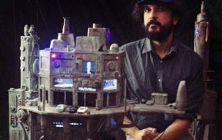 A shot of Nicola and one of his 3D printed designs. Image via Nicola's Kickstarter.