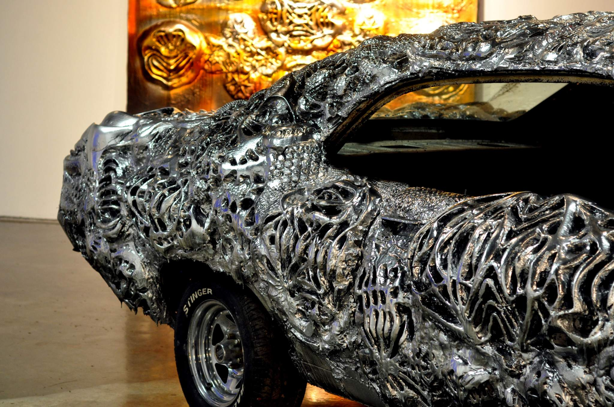 Close-up of the intricate metal design on Florea's Ford Torino. Photo via Floreaart.