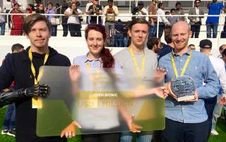 The Open Bionics team with their million dollar cheque. Photo via Open Bionics.