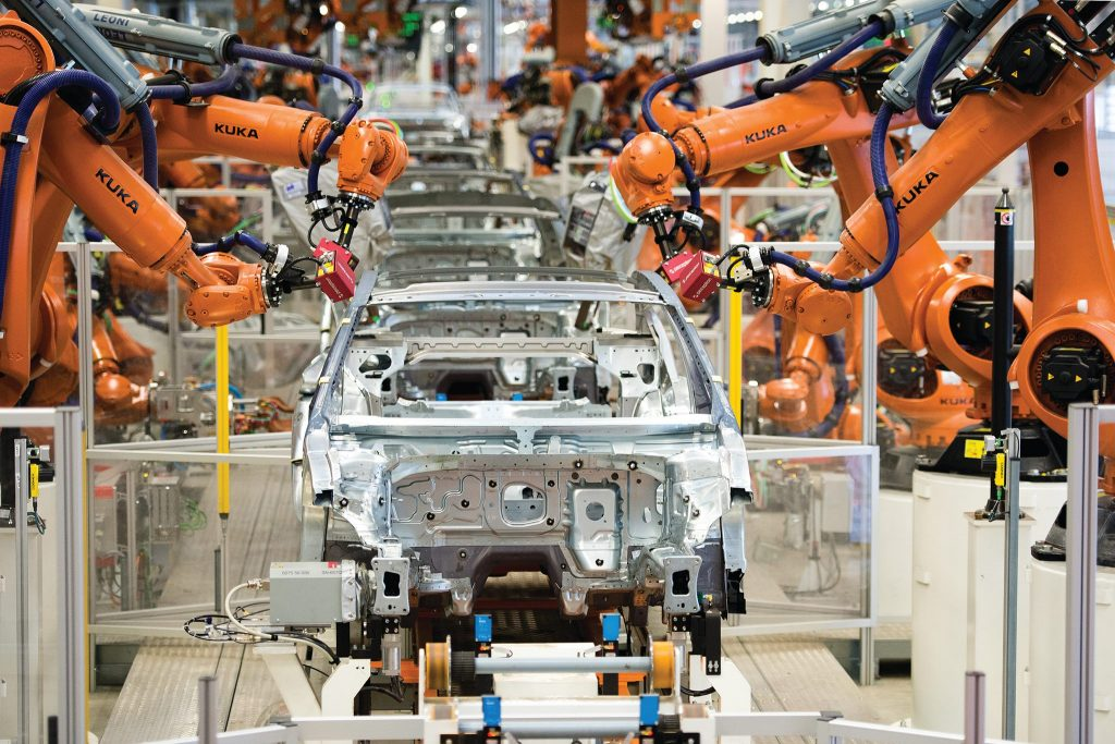 Perceptron sensors attached to KUKA robotic arms on a automotive production line. Photo via: PerceptronMetrology on Facebook
