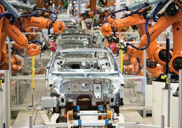 Perceptron sensors attached to KUKA robotic arms on a automotive production line. Photo via: PerceptronMetrology on Facebook