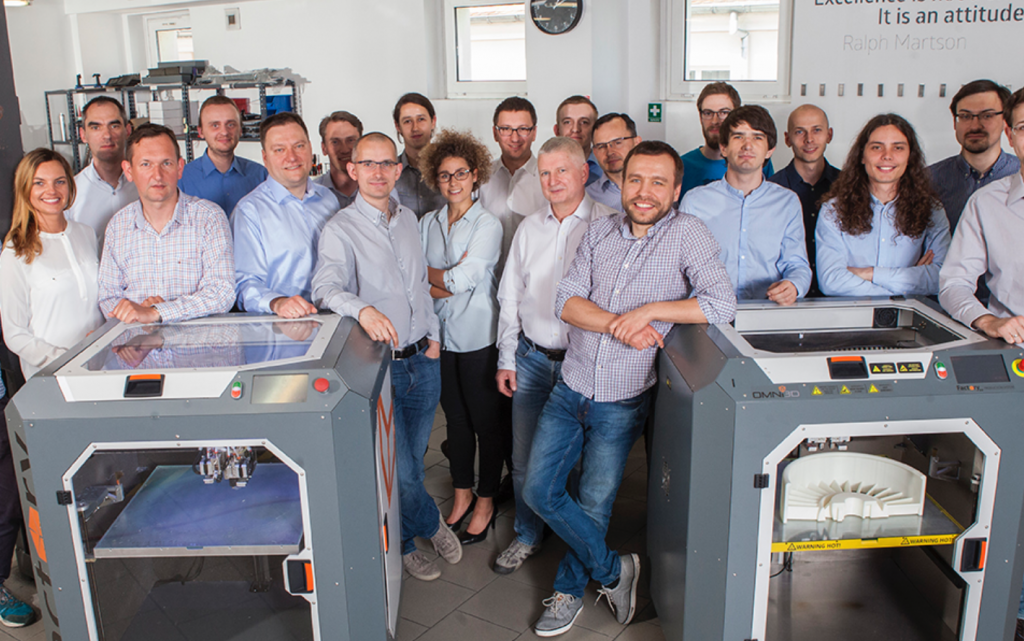 OMNI3D team and their Factory 2.0 3D printers. Photo via omni3d.com