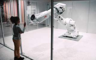 """The """"sentient"""" Mimus robotic ABB arm that interacts with humans. Art installation by Madeline Gannon"""