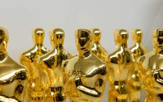 Finished gold plated Oscars. Photo via Police Tallix. Oscar Statuette ©A.M.P.A.S.