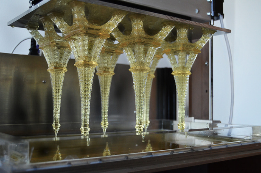 SLA 3D printed Eiffel Towers on the print platform. Photo via Tangible Engineering Corporation