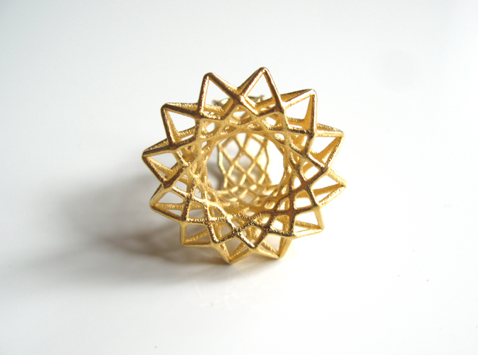 A 3D printed gold ring. Photo via Broke and Beautiful.