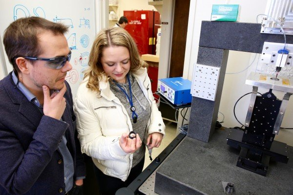 James Lewicki and Jennifer Rodriguez looking at a 3D-printed carbon fiber part created using their technique. Photo via Kate Hunts/LLNL.