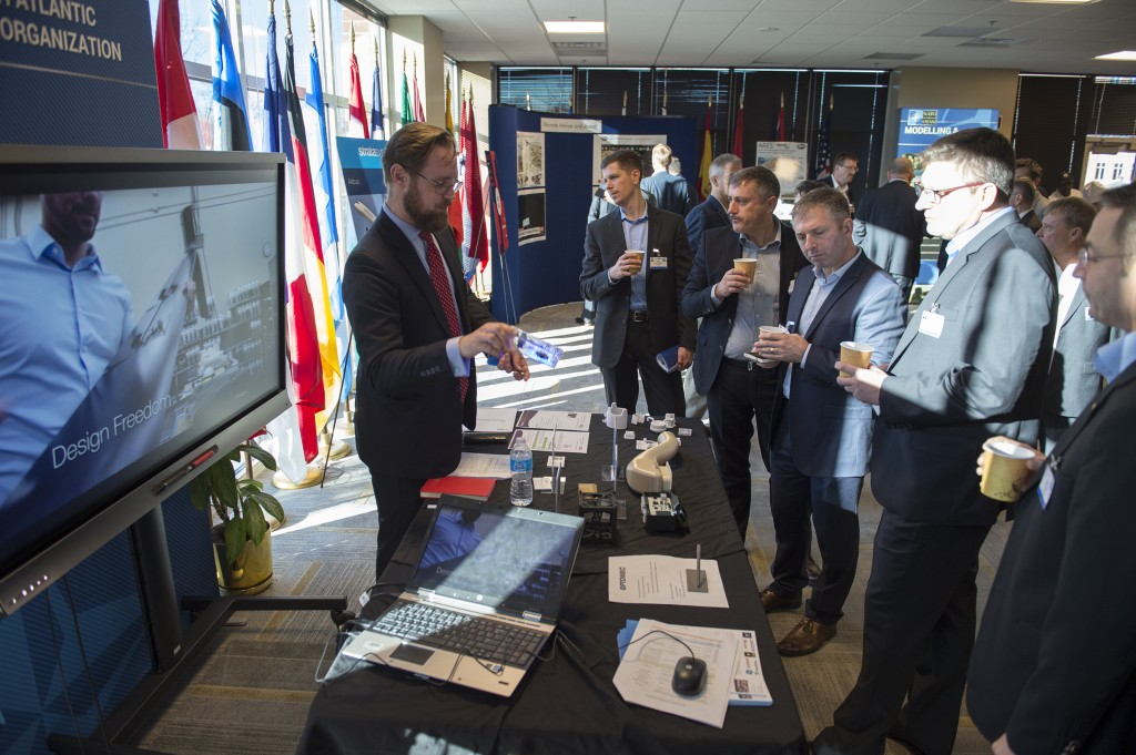 3D Printing Industry's Michael Petch demonstrates Optomec's 3D printed electronics to NATO during Allied Command Transformation event in Virginia.