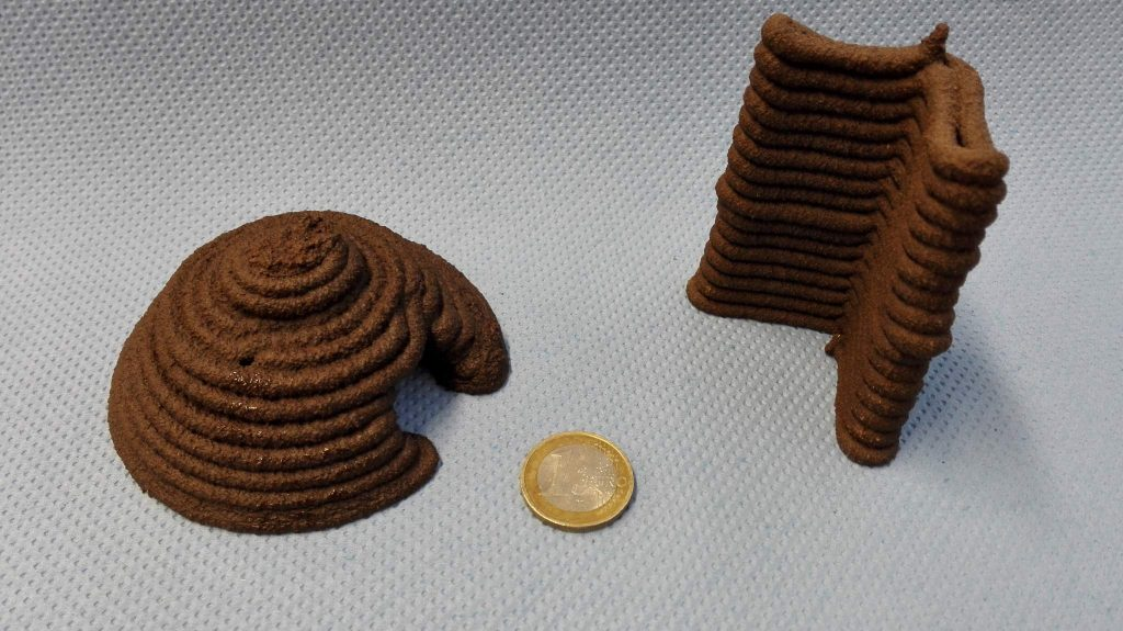 Igloo and corner of a wall 3D printed in Martian regolith simulant material 'JSC-Mars-1A' Photo via Fotec
