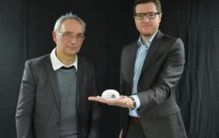 Julien Payen, right and Pierre-Marie Danze with the 3D printed implant. Photo via La Voix du Nord.