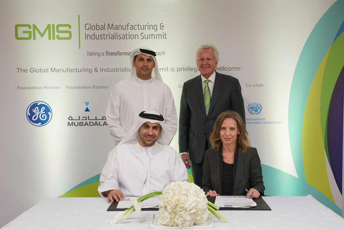 Badr Al-Olama with GE's Jeff Immelt and Rania Rostom. Photo via GMIS on twitter.