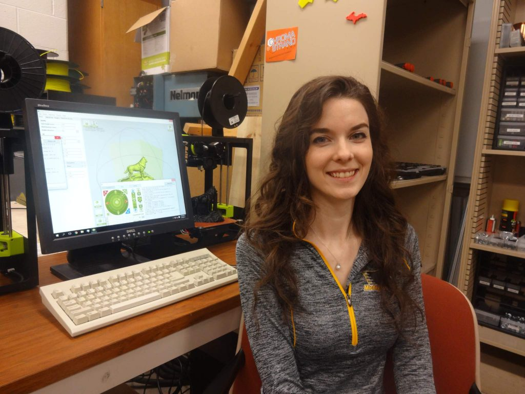 Michigan Tech student with several open source Lulzbot Mini RepRap derived 3-D printers (photo: J Pearce, GNU FDL).