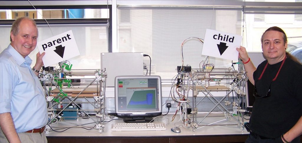 The first RepRap. All of the plastic parts for the machine on the right were produced by the machine on the left. Adrian Bowyer (left) and Vik Olliver (right) are members of the RepRap project.