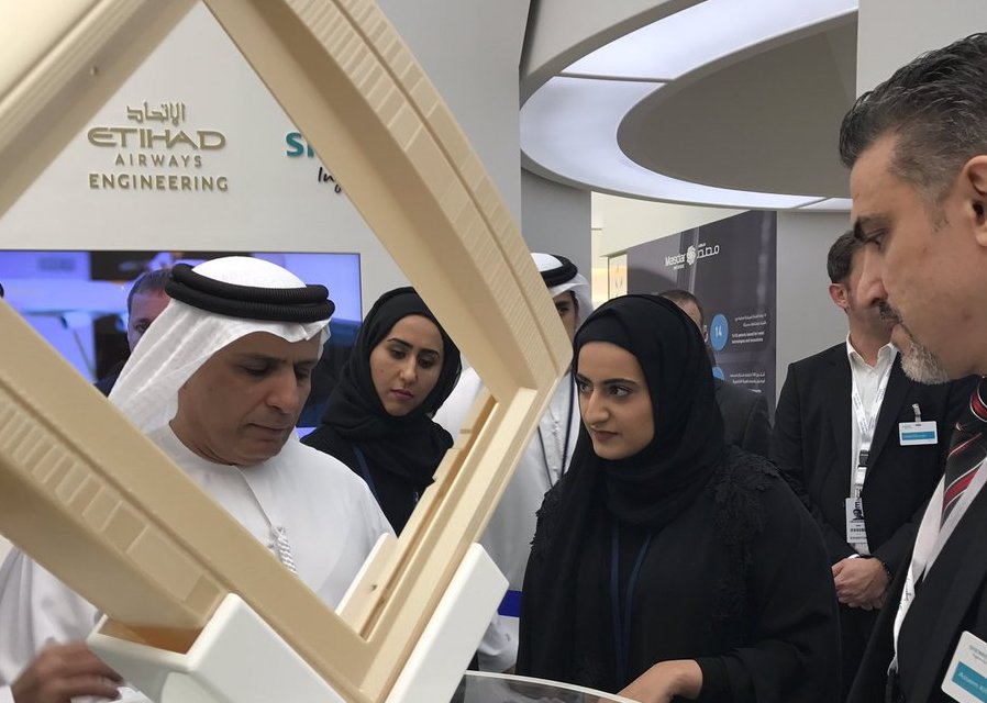 H.E. Mattar Mohammed Al Tayer views the 3D printed frame. Photo via Strata Manufacturing on Twitter