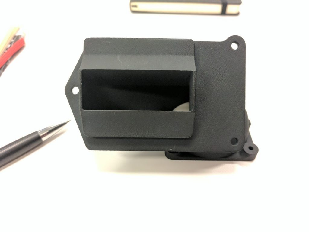 HP MJF 3D printed part. Photo by Michael Petch