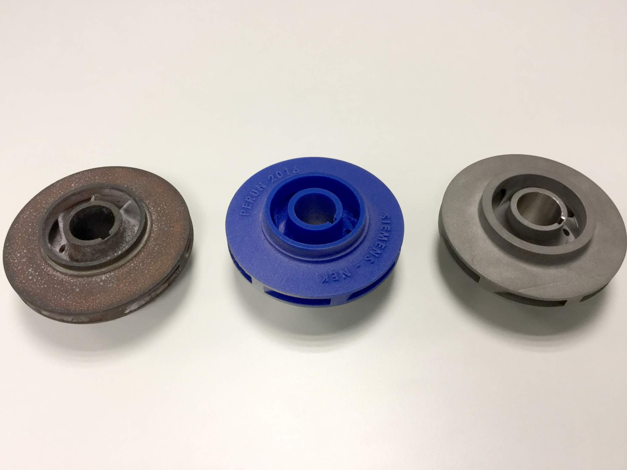 "From left to right, the ""original, obsolete water impeller, Siemens' 3D printed prototype and the resulting 3D-printed replacement installed and operating in Krško NPP in Slovenia."" Photo via Siemens."