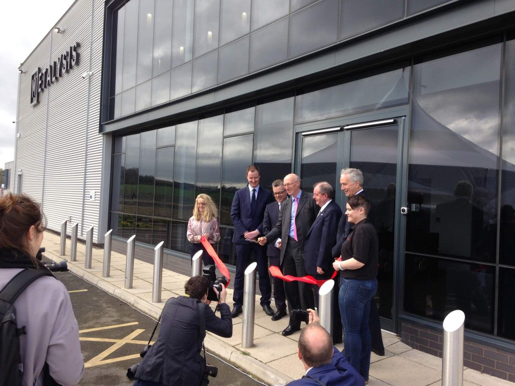 Company chairman, government representative and CEO Dion Vaughan (second from the left) cut the ribbon outside the Metalysis Materials Discovery Center.
