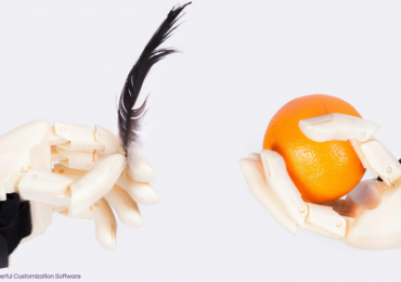 3D printed hands designed by WiDE. Photo via Fricis Pirtnieks