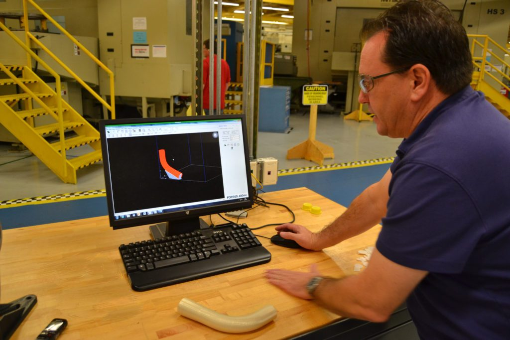Randy Meeker redesigns the duct for 3D printing. Photo via NAVAIR