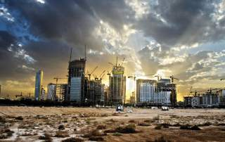 Construction of a financial district in Saudi Arabia. Photo via Bloomberg.
