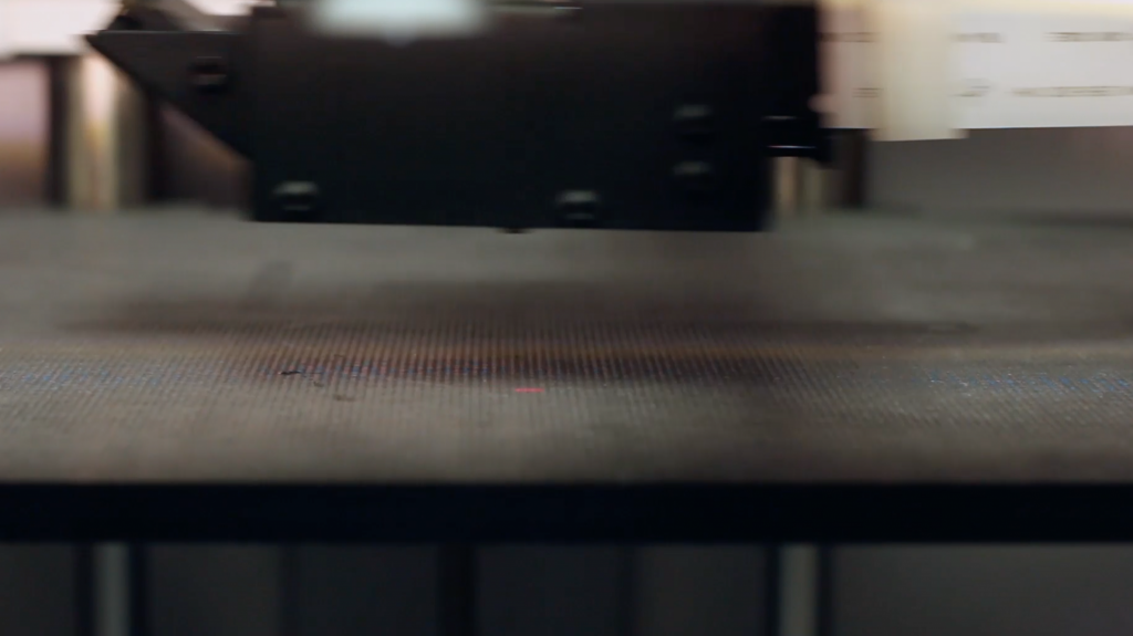 Laser scanning of the print bed in the Mark X. Photo via Markforged