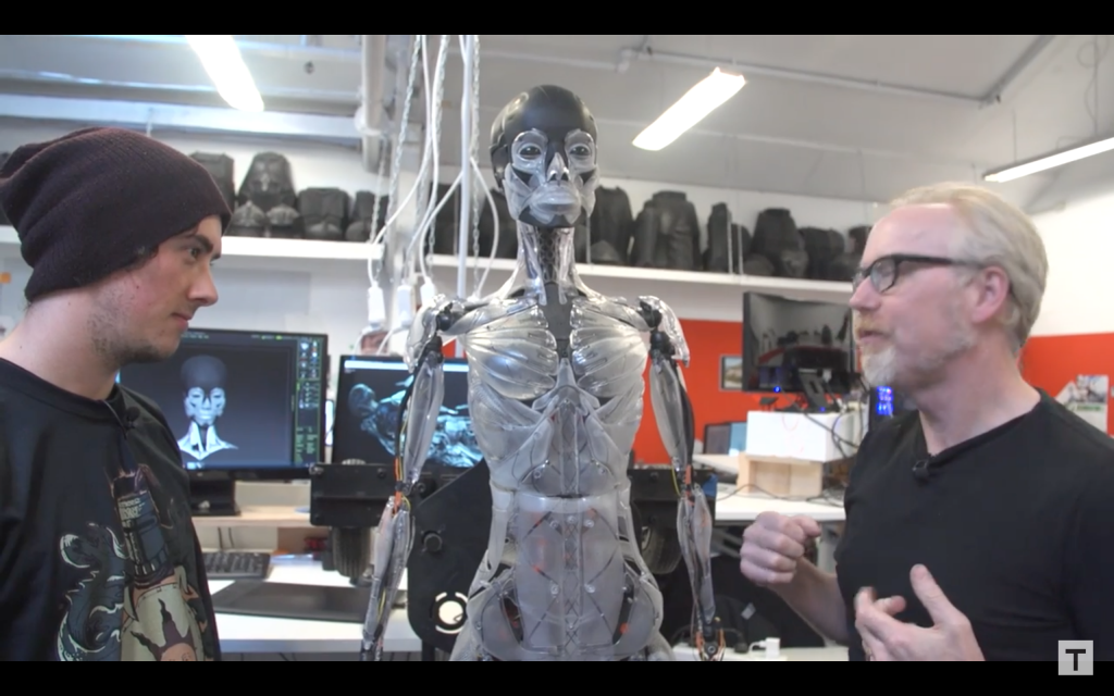 Adam Savage speaks to Weta Workshop technician Jared Haley about the 3D printed Ghost in the Shell robot skeleton. Screenshot via Tested on Youtube