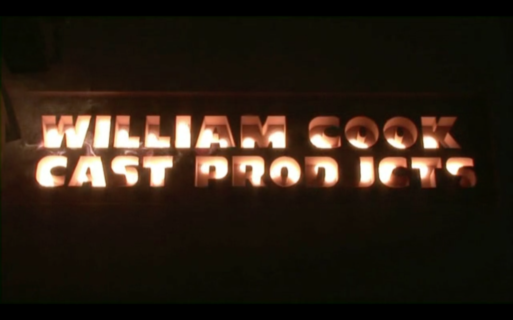 William Cook Cast Products logo filled with molten metal. Photo via William Cook Holdings