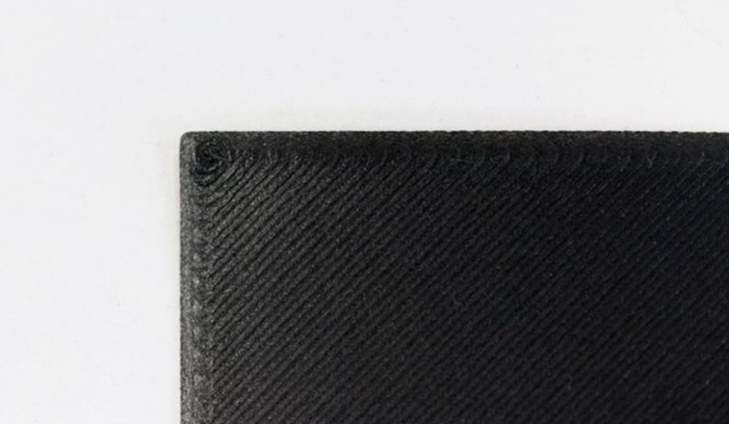 The first layer of an object 3D printed on the Mark X.