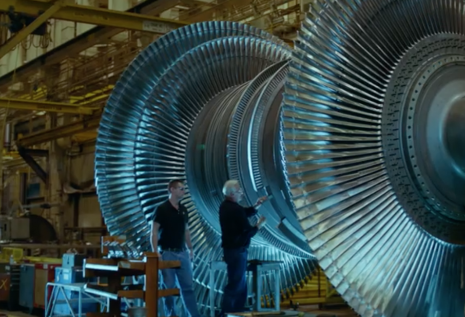 Putting the finishing touches on a turbine at GE. Screenshot via GE Ecomagination and the Power of Digital Efficiency - GE on YouTube