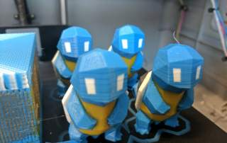 Squirtle army 3D printed on single nozzle Dremel using Mosaic Manufacturing Palette color mixer. Design by Flowalistik. Photo by Michael Petch