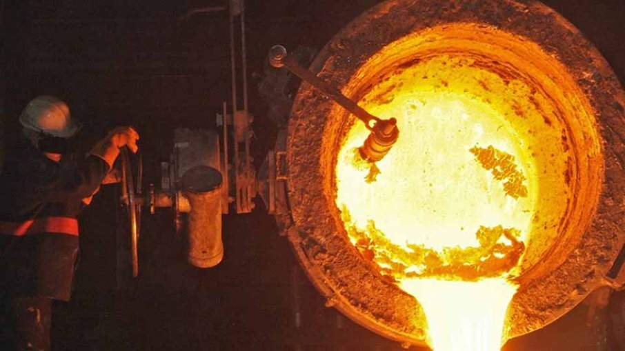 Molten metal poured out of a crucible at the Sheffield foundry. Photo via William Cook