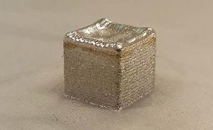 A 3D printed cube of BNNT/Titanium. Photo via Deakin University