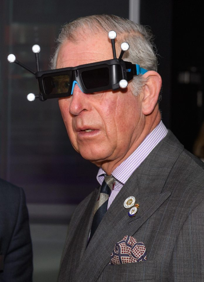 The Prince of Wales with his VR glasses. Photo via Rex Features.