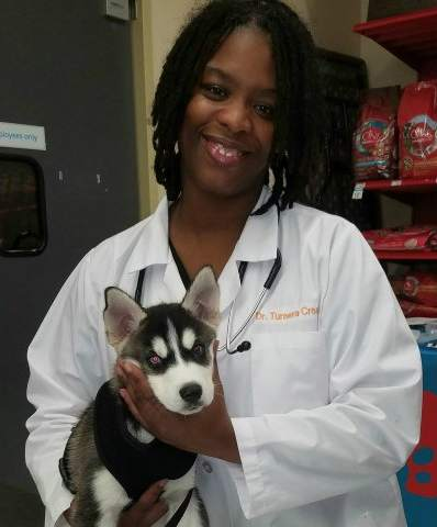 Dr. Turnera Croom and a non-3D printed canine. Photo via Vets in 3D.