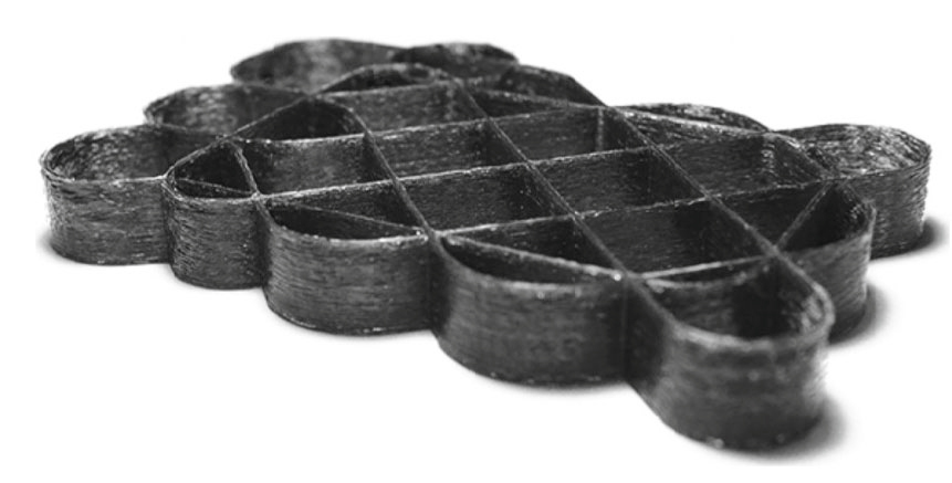 A sample lattice construct 3D printed in two-matrix carbon fiber composite material. Photo via Azarov, A.V., Antonov, F.K., Vasil'ev, V.V. et al. Polym. Sci. Ser. D (2017