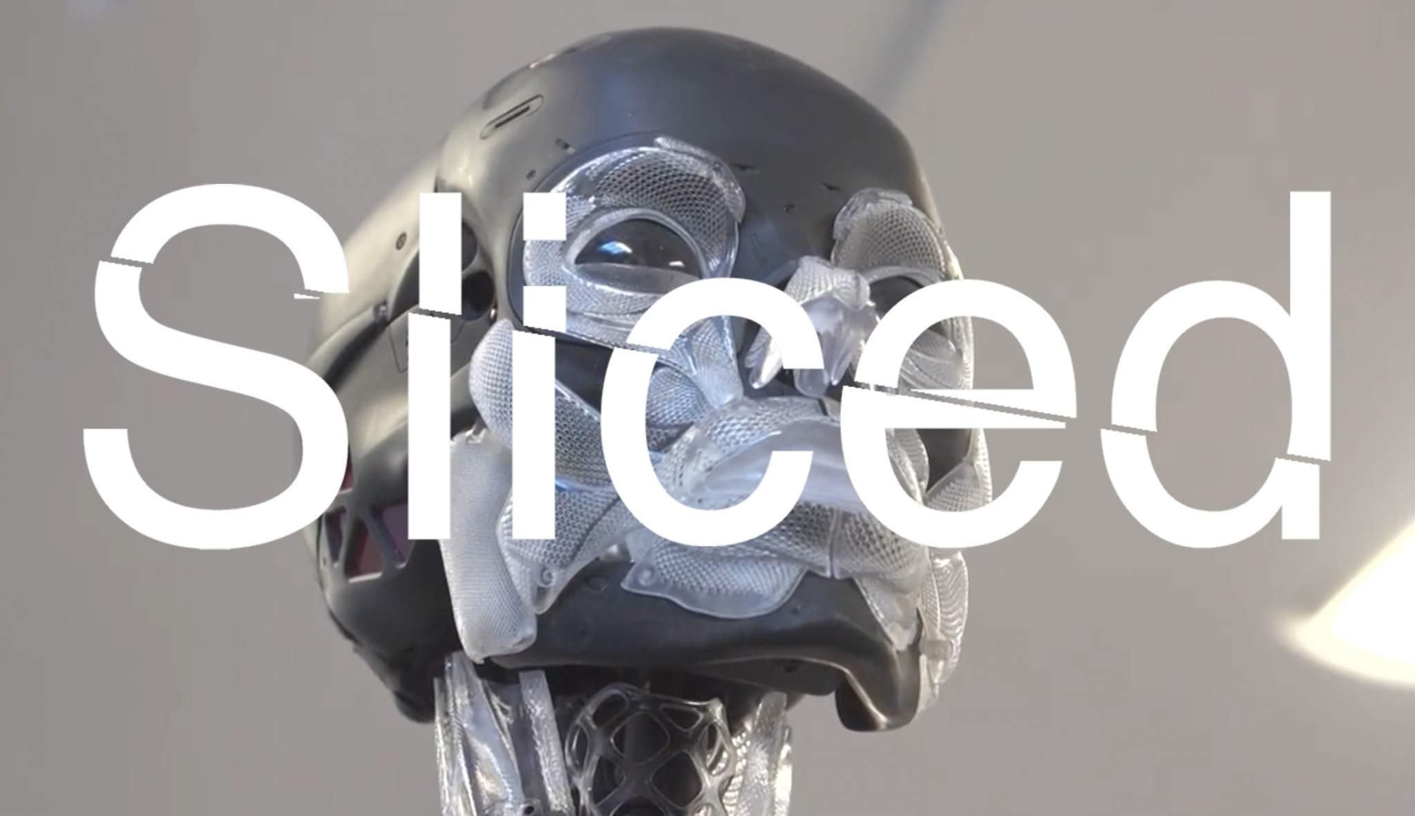 Sliced logo over Weta Workshop's 3D printed robot skeleton for Ghost in the Shell 2017. Original screenshot via Tested on YouTube