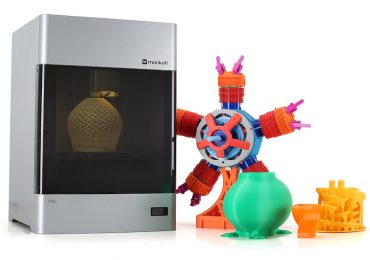 Mankati E180 3D printer and sample prints. Photo via Mankati