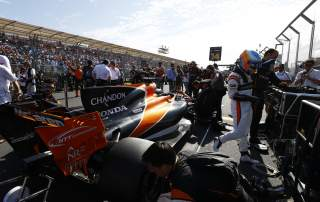 Fernando Alonso on the grid of the opening Melbourne Grand Prix with the McLaren RCL32. Photo by Steven Tee/McLaren.