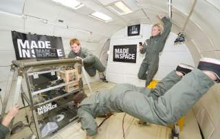 Testing the Made In Space 3D printer inside the Microgravity Science Glovebox (MSG) Engineering Unit at Marshall Space Flight Center. Photo by NASA
