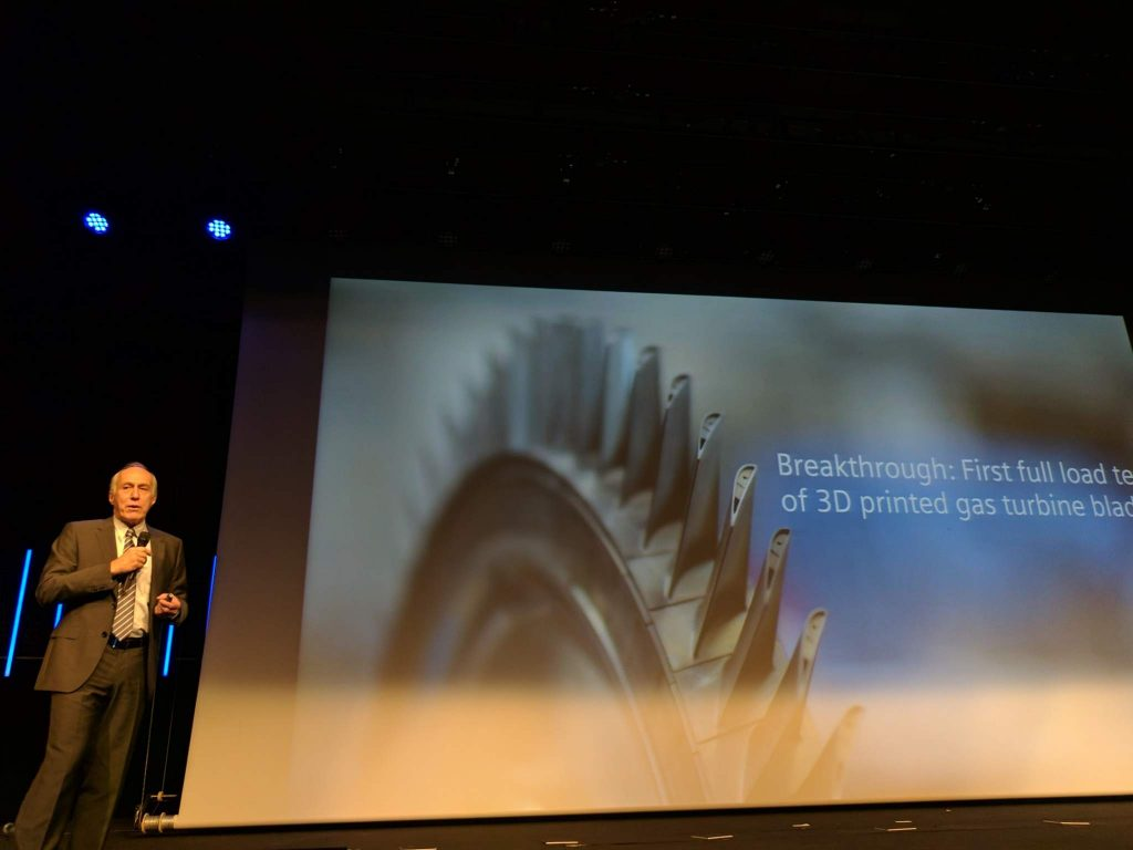 Andreas Saar from Siemens describes the breakthrough 3D printed gas turbine blade at the 2017 Materialise World Summit. Photo by Michael Petch.
