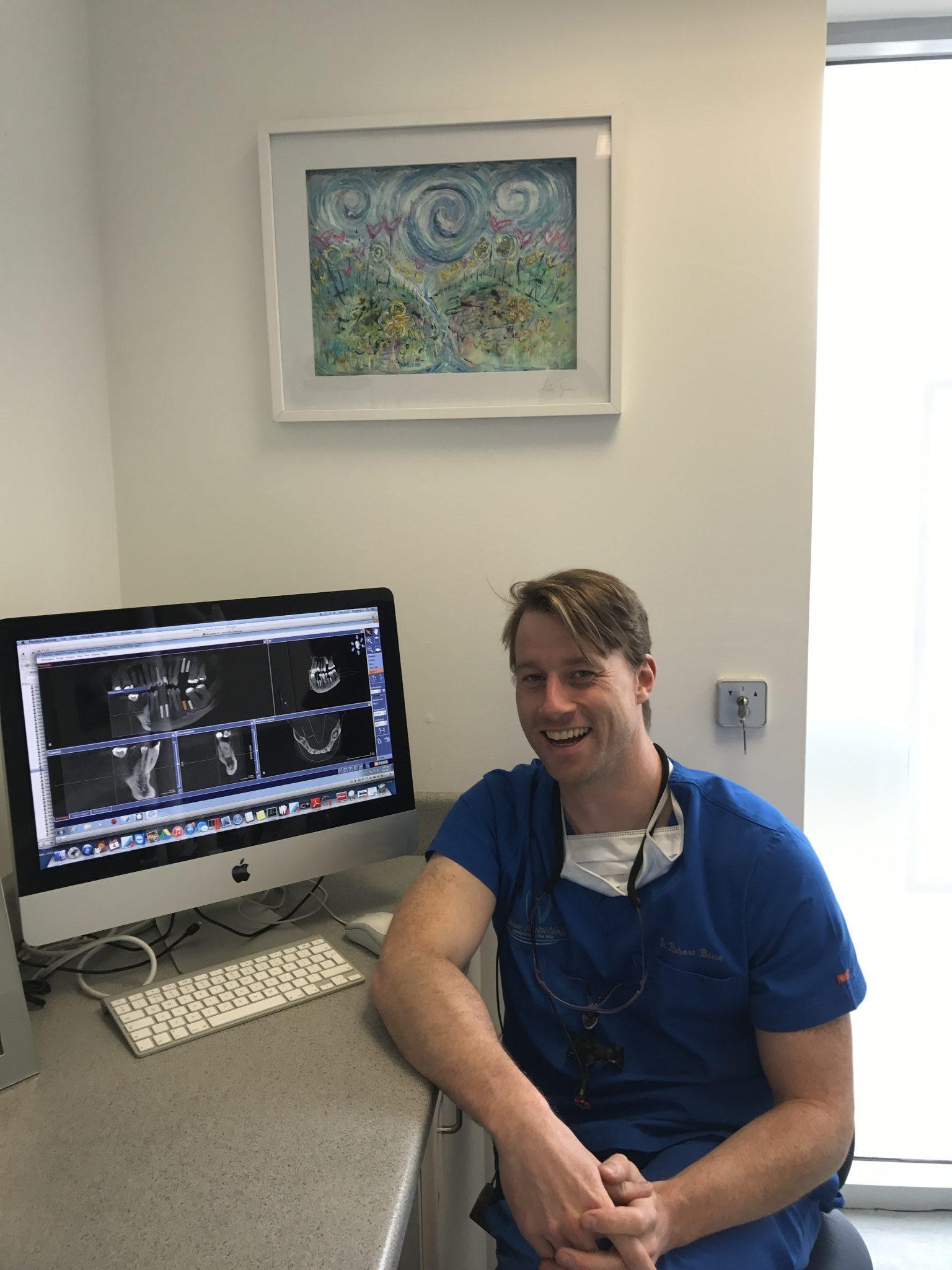 Dr Robert Bowe with 3D digital scans. Photo via Limerick Post.