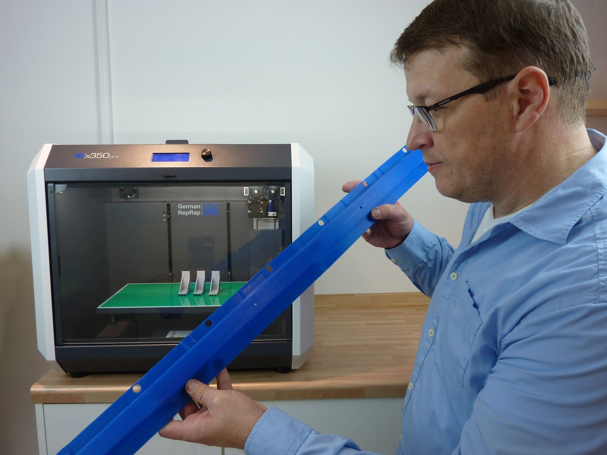 Inspecting a 3D printed part for the automotive industry. Photo via German RepRap.