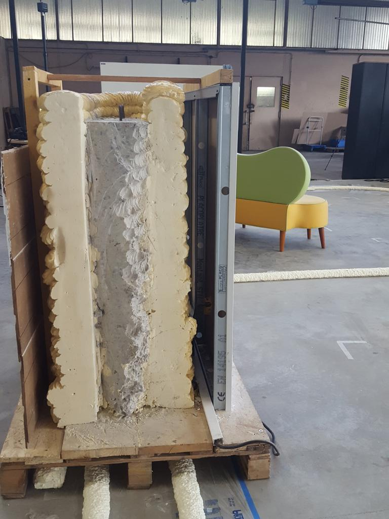 The 3D printed walls containing the concrete structure. Photo via the University of Nantes.
